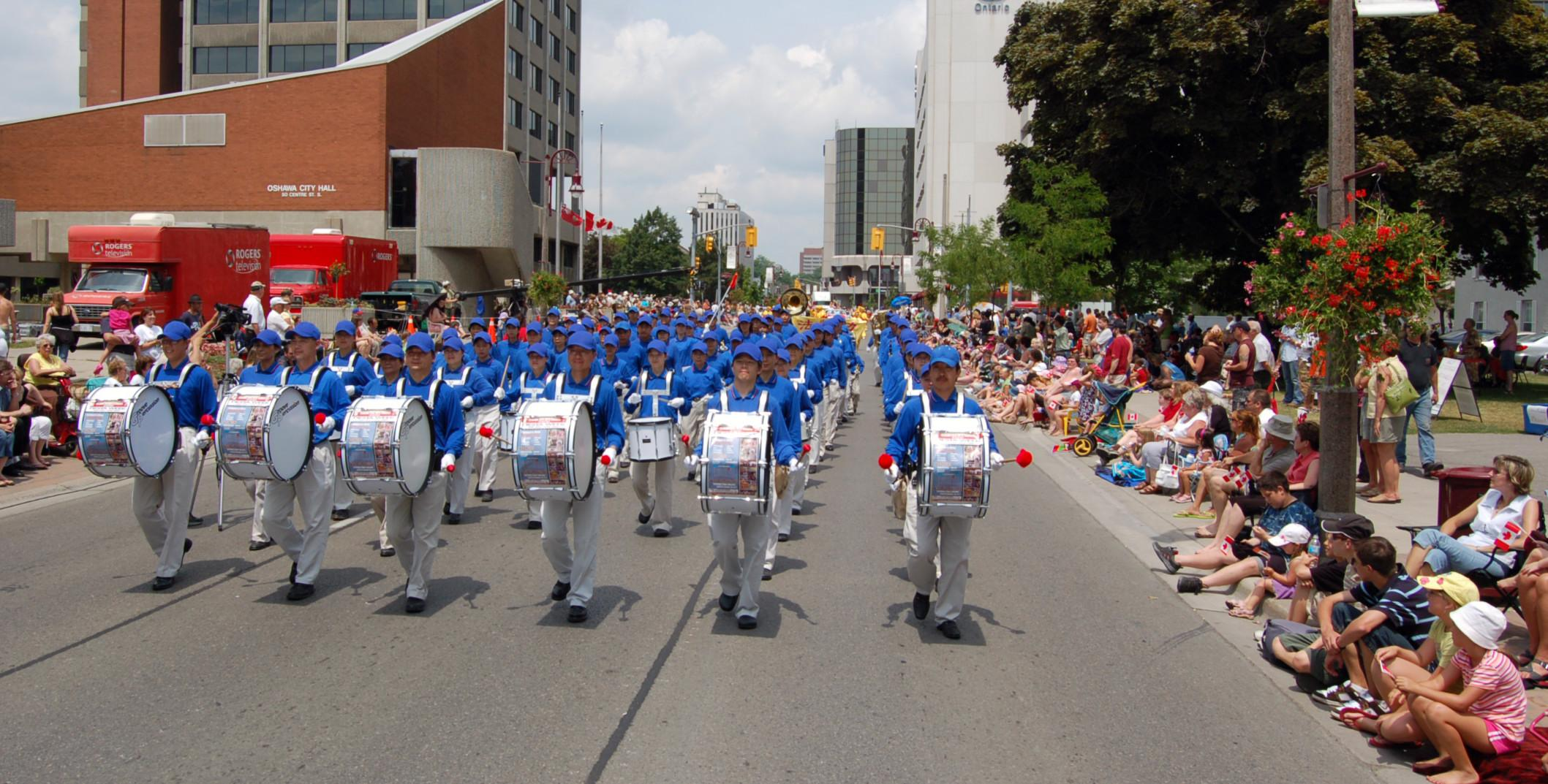 toronto practitioners display good demeanor at the oshawa canadian divine land ing band performs in the parade